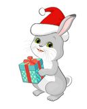 Illustration featuring a cartoon rabbit in a red Santa hat with gift box. Royalty Free Stock Photography