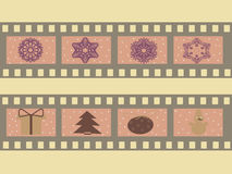 Illustration of a film strip with Christmas symbols, attributes, snowflakes. Christmas  illustration with film strips and snowflakes, vector illustration Royalty Free Stock Photography