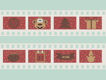 Illustration of a film strip with Christmas symbols attributes. Christmas  illustration 2016 with film strips and snowflakes, gift, monkey, calendar, snowman Stock Images