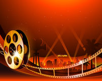 Illustration of a film stripe reel on shiny red movie background Royalty Free Stock Image