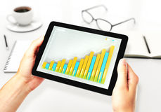 Illustration of Financial graph on a digital tablet. Close up Royalty Free Stock Photo