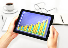 Illustration of Financial graph on a digital tablet in office. Close up Stock Photo
