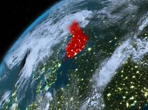 Finland on planet Earth in space at night. Illustration of Finland as seen from Earth's orbit at night. 3D illustration. Elements of this image furnished by Royalty Free Stock Photos