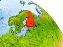 Finland in red model of Earth. Illustration of Finland highlighted in red on glob with realistic surface with visible country borders, and water in the oceans Royalty Free Stock Images