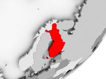 Finland in red on grey map. Illustration of Finland highlighted in red on grey globe. 3D illustration Stock Images