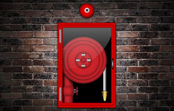 Illustration of a fire hose. Illustration of a fire hose against a brick wall Stock Images