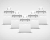 Illustration of four white shopping bag Stock Images