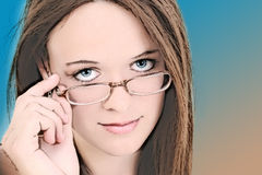 Illustration of Fourteen Year Old In Girl Eyeglasses. With brown and blue background Stock Image