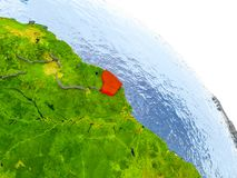 French Guiana in red model of Earth. Illustration of French Guiana highlighted in red on glob with realistic surface with visible country borders, and water in Stock Photography