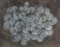 Gel pen drawing of circles on dark paper. An illustration of a gel pen drawing on a dark textured paper Royalty Free Stock Photo
