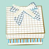 Illustration of a gift box with stripes and two bows isolated on blue background royalty free stock photos