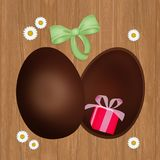 Gift in the Easter chocolate egg. Illustration of gift in the Easter chocolate egg Royalty Free Stock Photos