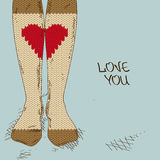 Illustration with girl's feet in knitted stockings. Illustration with close up girl's feet in heart ornament knitted stockings Stock Photo