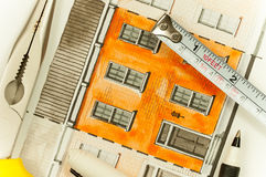 Illustration graphic orange shared twin elevation facade fragment with brick wall texture tiling shot with tools and measure tape. Illustration graphic material Royalty Free Stock Photography