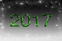 Illustration 2017 in green color on black and white background with sparkling stars stock photo
