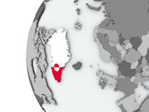 Greenland on globe with flag Stock Photo