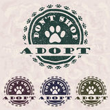 Adopt don't shop. Illustration of grunge vintage pet related slogan, label, stamp with paws and text 'adopt don't shop' in it stock illustration