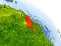 Guyana in red model of Earth. Illustration of Guyana highlighted in red on glob with realistic surface with visible country borders, and water in the oceans. 3D Royalty Free Stock Image