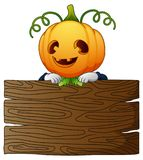 Halloween cartoon scarecrow with wooden board Stock Image