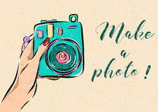 Illustration of hand holding a photo camera. Stock Photography