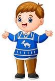 Happy boy cartoon wearing blue christmas sweater. Illustration of Happy boy cartoon wearing blue christmas sweater Royalty Free Stock Photo