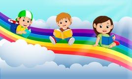 Happy children reading book over the rainbow stock illustration