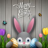 Happy easter with rabbit holding two egg colorful on wooden gray background. Illustration of Happy easter with rabbit holding two egg colorful on wooden gray Stock Photo