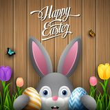 Happy easter with rabbit holding two egg colorful on wooden gray background. Illustration of Happy easter with rabbit holding two egg colorful on wooden gray Stock Photography