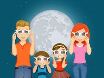Happy family look the eclipse Royalty Free Stock Photo