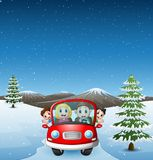 Happy family riding car in the snowing hill Stock Photos