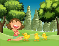 A happy girl and the three ducklings Stock Image