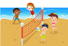 Happy kids playing beach volleyball Royalty Free Stock Photo