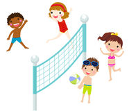 Happy kids playing beach volleyball Stock Images
