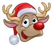 Christmas Reindeer in Santa Hat Royalty Free Stock Photos