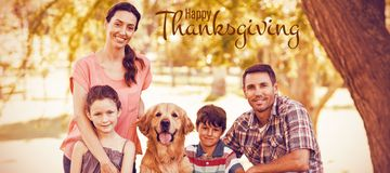 Composite image of illustration of happy thanksgiving day text greeting. Illustration of happy thanksgiving day text greeting against portrait of happy family Royalty Free Stock Image