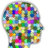 Psychology head. Illustration of a head full of colourful jigsaw pieces Stock Images