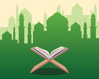 Illustration of Holy Qoran on wood table with green silhouette of a mosque with dome and towers as background Stock Photography