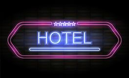 Hotel neon sign on brick wall Royalty Free Stock Image