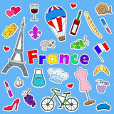 Illustration with Icons set of patches on the subject of travel to the country of France on a blue background. Icons set of patches on the subject of travel to Stock Photos