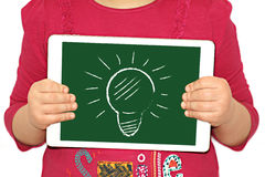 Illustration - the idea came up. Girl holds a plate with a picture of a light bulb, the idea was found Stock Photo