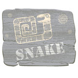 Illustration with the image of a snake in tribal style on the texture of wood. Royalty Free Stock Photography
