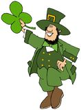 Leprechaun dancing a jig and holding a large 4 leaf clover royalty free stock photography