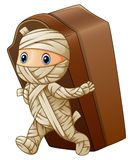 Kid in a mummy costume with coffin Stock Images