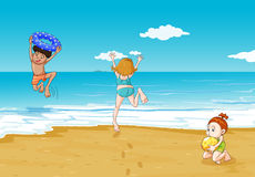 Kids on seashore Stock Image
