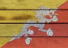 Kingdom of Bhutan flag on wooden surface Royalty Free Stock Photos