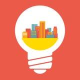 Illustration: a large city in lightbulb Stock Photos