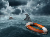 Lost at sea. Illustration of a lifebuoy adrift in the ocean surrounded by hungry sharks Royalty Free Stock Photo