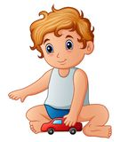Little boy playing toy car Stock Image