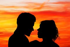 Lovers kissing at sunset. Illustration of lovers kissing at sunset Royalty Free Stock Photo