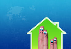 Low-power of green house with cute family fingers. Illustration of low-power of green house with cute family fingers Royalty Free Stock Photos